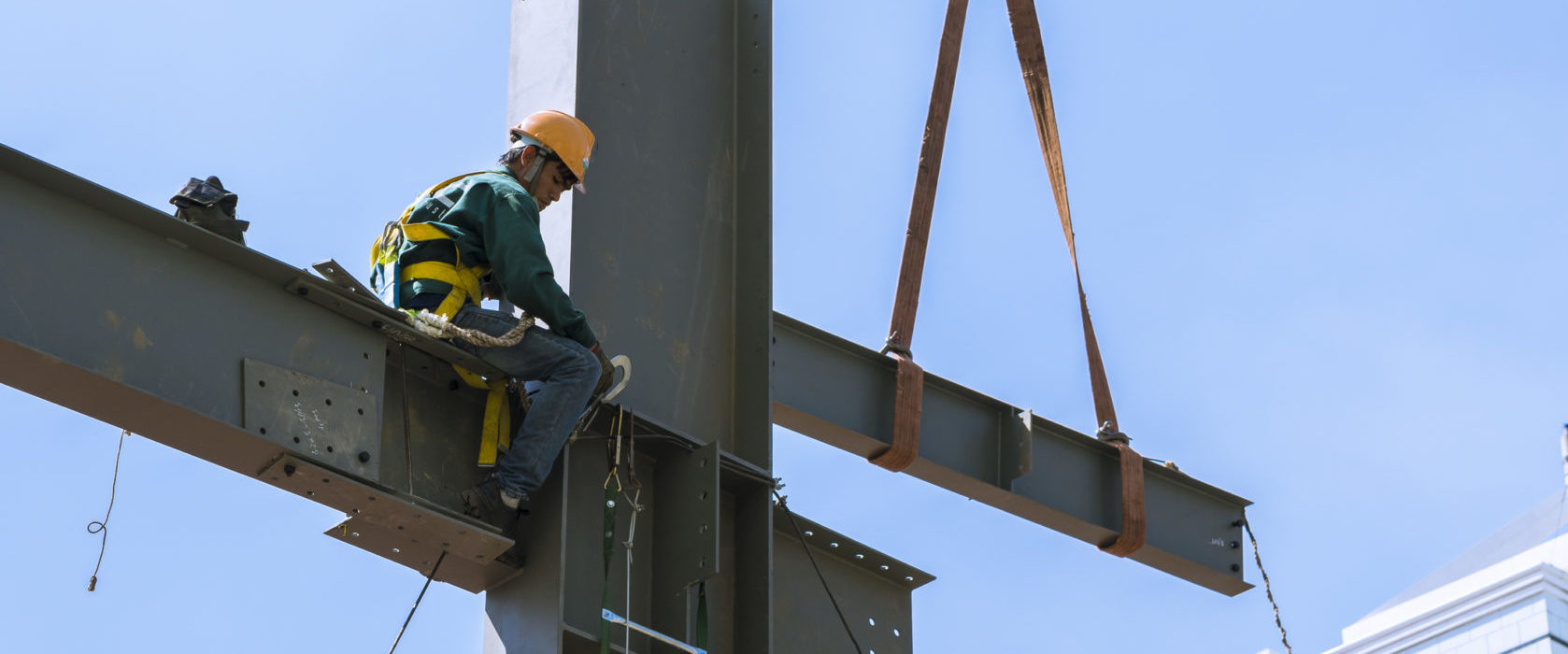 Builder workers in safety protective assemble metal construction frame